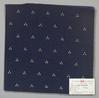 Weft-faced twill in dark blue with a triple dot pattern produced by a discharge printing process. Number 730.