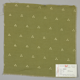 Plain weave in yellow-green with a triple dot pattern produced by a discharge printing process. Number 512.
