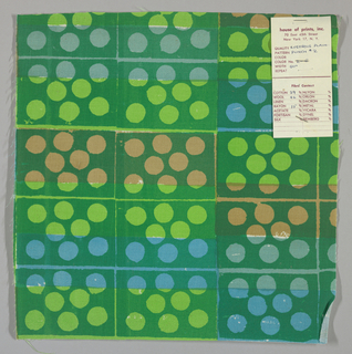 White plain weave hand printed in a pattern of rectangles and circles in light green, dark green, blue, blue-grey and tan. Color no. 2e