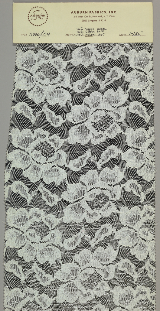 A sample of silver color sheet metal with cotton backing and nylon lace overlay.