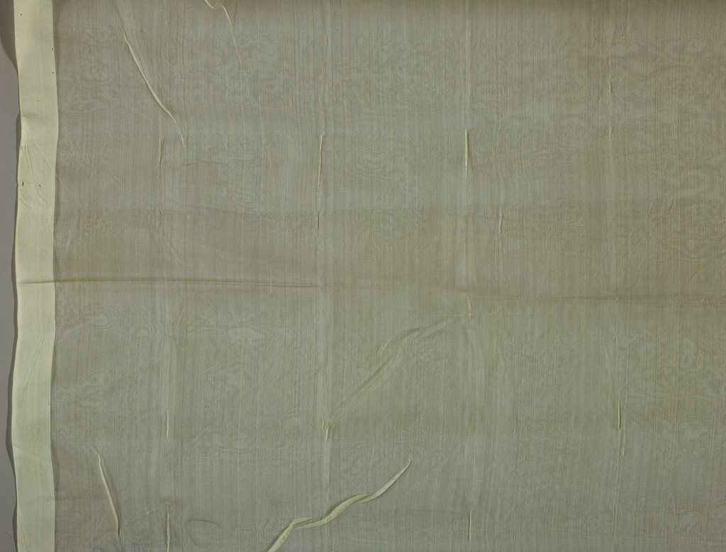 Ivory-colored sheer organdy fabric.