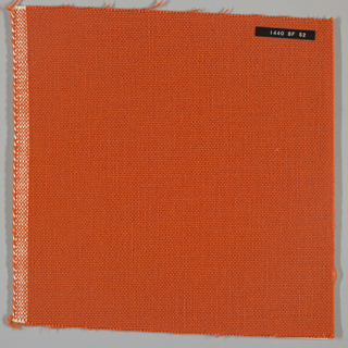 Plain weave with orange warp and weft. Heavy nylon yarns give a coarse surface texture.