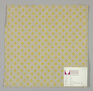 """Light brown plain weave printed with a pattern of intersecting """"barbells"""" in yellow. Number 75102."""