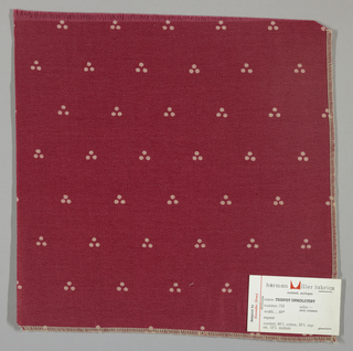 Weft-faced twill in dark red with a triple dot pattern produced by a discharge printing process. Number 733.