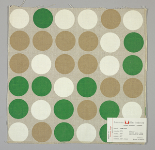 Light brown plain weave printed with circles in green, light brown and white. Number 574.
