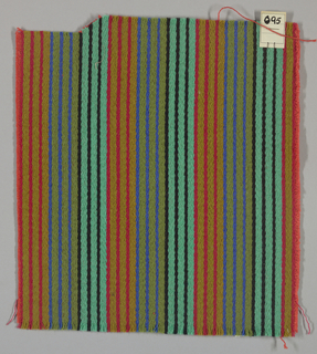 Warp-faced twill weave in narrow vertical stripes of olive green, red, light green, black, and blue. Binding weft threads in red-orange on the reverse.