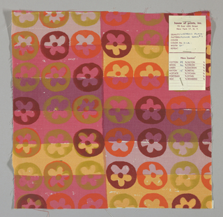White plain weave hand printed with horizontal bands of violet, dark pink, pale pink and pale orange overprinted with a flower pattern in dark red, orange and olive green. Color no. 7a