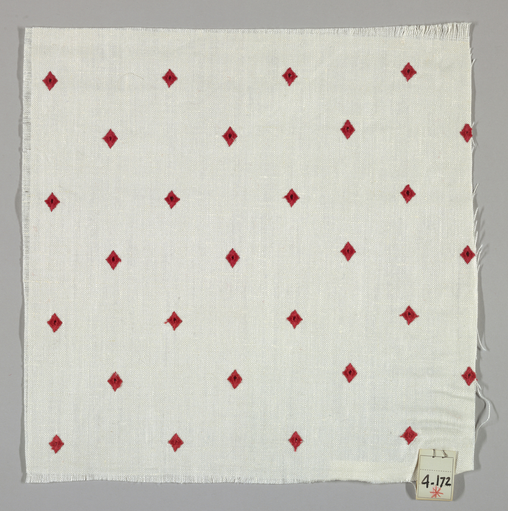 Plain weave in white with red embroidered diamonds. Diamonds have a small hole in the center.