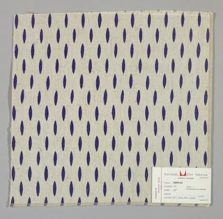 Off-white plain weave printed with dark blue ovals. Number 721.