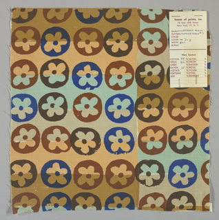White plain weave hand printed with horizontal bands of light brown, tan, light green and pale orange overprinted with a flower pattern in dark brown, red-brown and blue. Color no. 7i