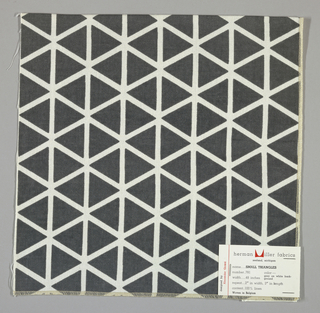 White plain weave printed with grey triangles. Number 781.