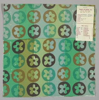 White plain weave hand printed with horizontal bands of green, olive green, light green and light turquoise overprinted with a flower pattern in dark brown, tan and green. Color no. 7e
