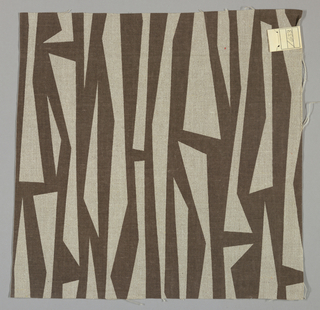 Light brown plain weave printed with a sharp geometric pattern in dark brown. Number 1633.