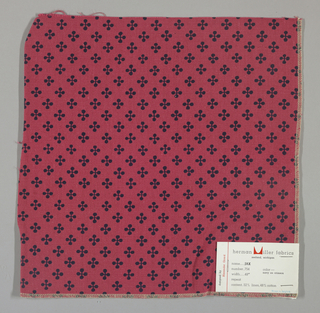 """Red plain weave printed with a pattern of intersecting """"barbells"""" in dark blue. Number 754."""