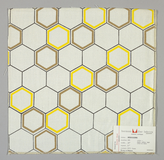 White plain weave printed with an outline pattern of dark brown, tan and yellow hexagons. Yellow and tan hexagons are printed in diagonal bands.