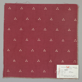 Plain weave in red with a triple dot pattern produced by a discharge printing process. Number 517.