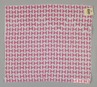 Sheer plain weave printed with a pattern of intersecting triangles in pink. Number 600.
