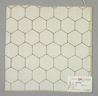 White plain weave printed with an outline pattern of brown hexagons.