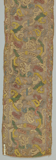 Multicolored embroidery on brown gauze weave in a pattern of flowers on curving and angular stems.