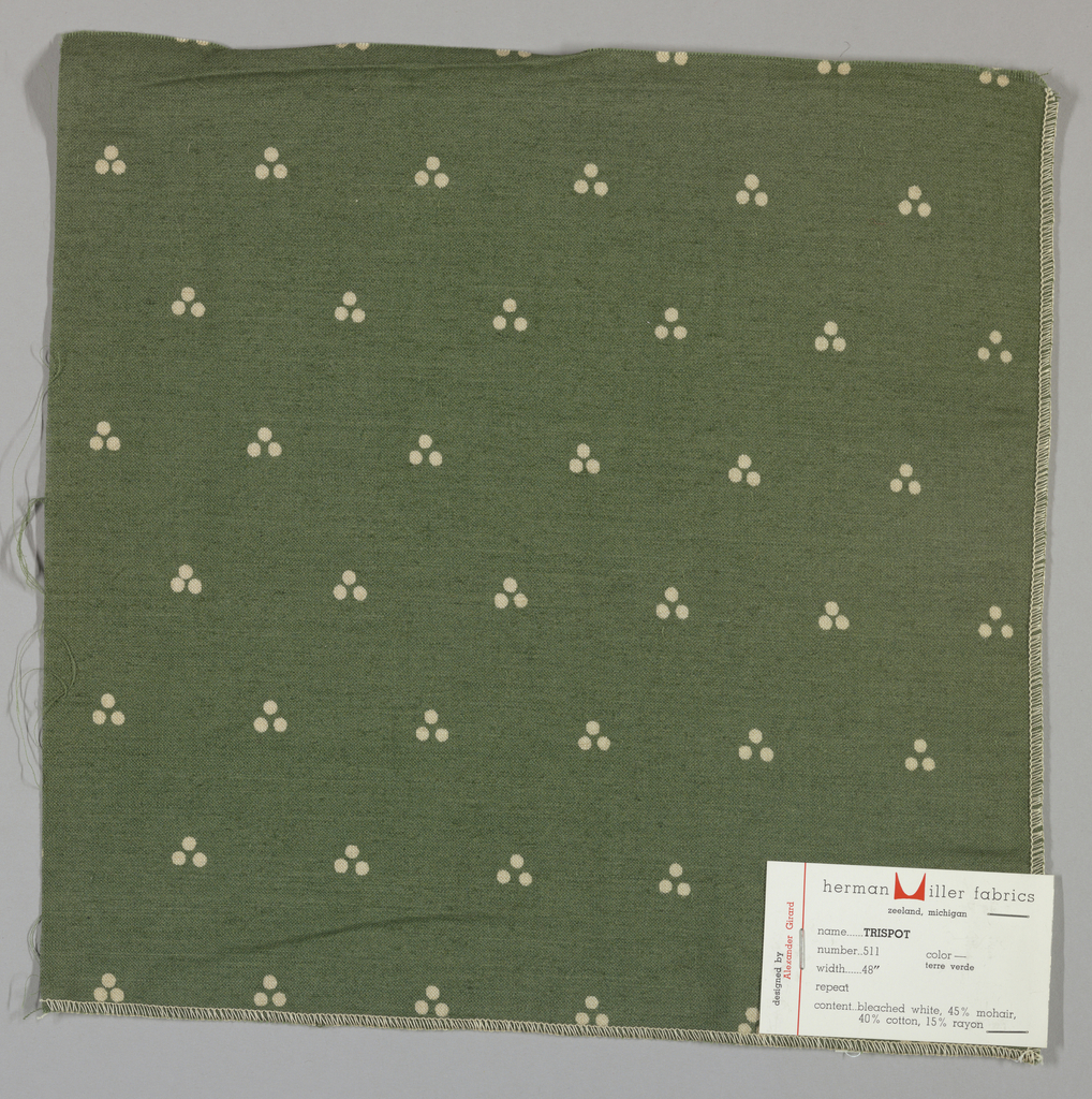 Plain weave in dark green with a triple dot pattern produced by a discharge printing process. Number 511.