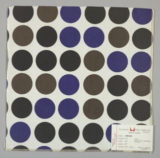 White plain weave printed with circles in black, dark brown and blue. Number 573.