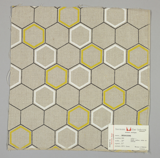 Light brown plain weave printed with an outline pattern of black, white and yellow hexagons. Yellow and white hexagons are printed in diagonal bands. Number 586.