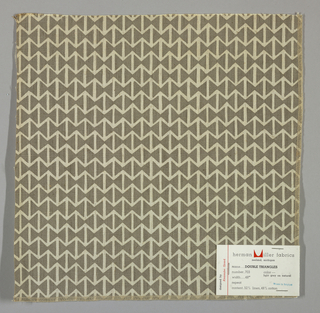 Light brown plain weave printed with a pattern of intersecting triangles in grey. Number 703.