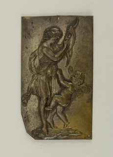 Vertical rectangle with irregular lower left corner. Repoussé figure of Artemis with putto.