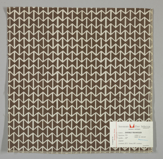 Light brown plain weave printed with a pattern of intersecting triangles in dark brown. Number 701.