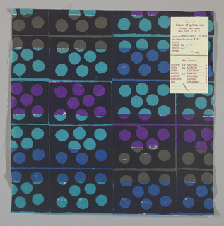 White plain weave hand printed in a pattern of rectangles and circles in turquoise, violet, blue, dark brown and black.