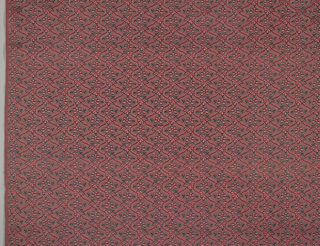 Woven textile. Minute diaper pattern with flowers in burgundy and grey.