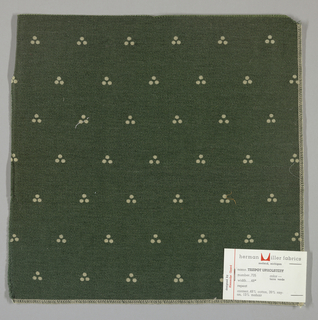 Weft-faced twill in dark green with a triple dot pattern produced by a discharge printing process. Number 735.
