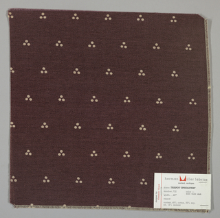 Weft-faced twill in red-violet with a triple dot pattern produced by a discharge printing process. Number 732.