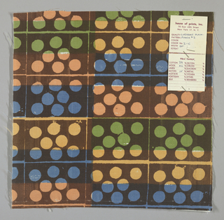 White plain weave hand printed in a pattern of rectangles and circles in blue, brown, green, pale yellow and pale orange.