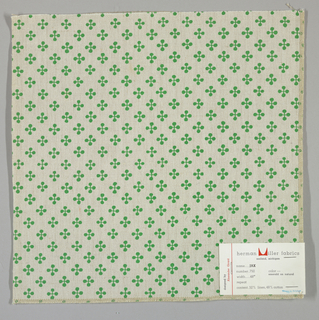 """Off-white plain weave printed with a pattern of intersecting """"barbells"""" in bright green. Number 750."""