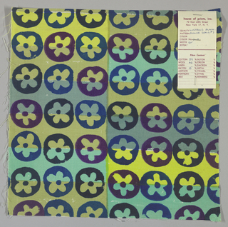 White plain weave hand printed with horizontal bands of yellow-green, olive green, light green and blue-grey overprinted with a flower pattern in dark blue, blue and violet. Color no. 7d