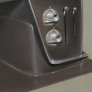 """Dark brown and grey sewing machine design with chrome strip featuring """"v"""" shape at head of machine."""