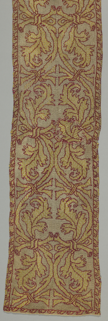 Border of linen gauze weave embroidered in yellow and red silk in a serpentine leaf and ribbon pattern.