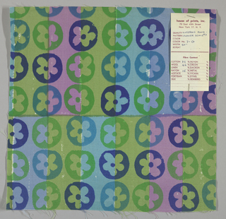 White plain weave hand printed with horizontal bands of green, light violet, light blue, and blue-violet overprinted with a flower pattern in dark blue, blue and green. Color no. 7g