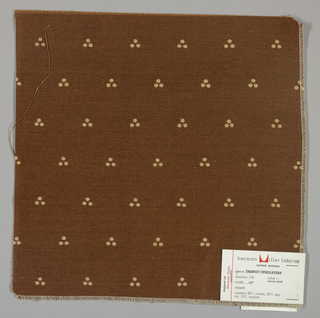 Weft-faced twill in brown with a triple dot pattern produced by a discharge printing process. Number 734.