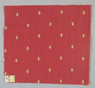 Plain weave in red with gold embroidered diamonds. Diamonds have a small hole in the center. Number 6.171.