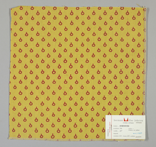 "Dark yellow plain weave printed with a red ""screw eye"" pattern consisting of a circle capped by a short vertical line."