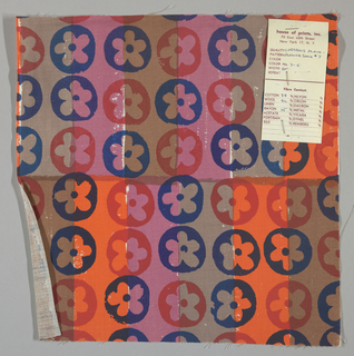 White plain weave hand printed with horizontal bands of dark pink, bright orange, taupe and brown overprinted with a flower pattern in red, dark blue and blue. Color no. 7c