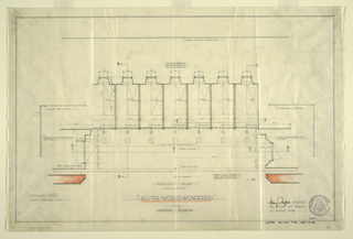 Horizontal view of architectural plan for stage design. Seven rectangular bedrooms at top, each with the bed placed in the upper right corner and each with a projecting window at the back; sliding doors open at the front of each room towards a common stage area.