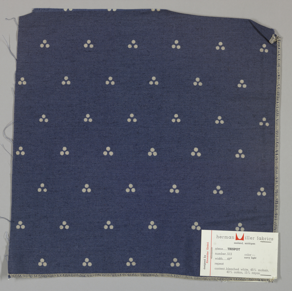 Plain weave in dark blue with a triple dot pattern produced by a discharge printing process. Number 513.