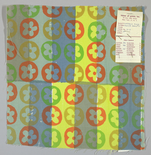 White plain weave hand printed with horizontal bands of yellow, light turquoise, grey and blue overprinted with a flower pattern in orange, green and tan. Color no. 7f