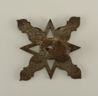 Pierced mount in eight part design of projecting barbs and petals.