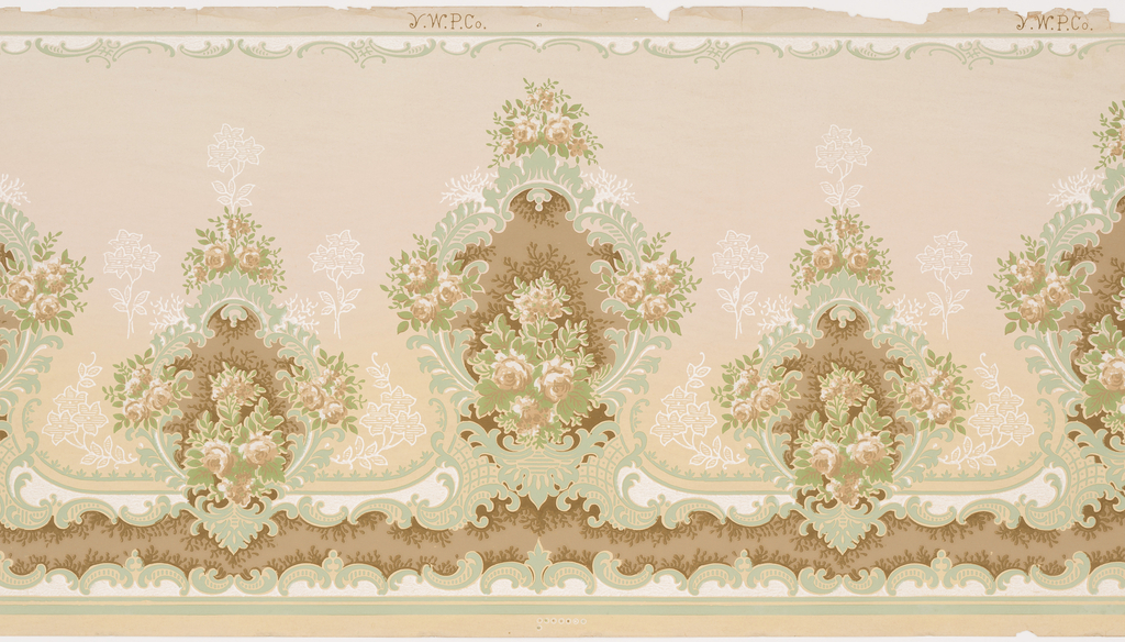 This frieze features alternating large and small medallions bordered by bunches of roses and stylized acanthus leaves. Floral sprays printed as only white outlines sprout from the medallions. A grid pattern supports the larger medallions, and rows of foliate c scrolls create scalloped borders on the top and bottom edges of the panel. This design was printed in shades of beige, brown, green and white on a tan background.