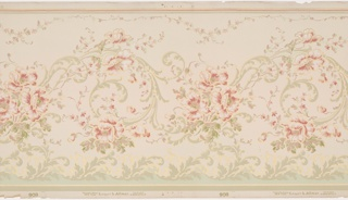 Frieze featuring central swirling vine profuse with pink blossoms. A dainty vine with smaller flowers meanders across the top border, while a border of thick leafy branches grow up from the bottom of the panel. The design is printed in shades of pink, red, pale green and gold on a beige background.