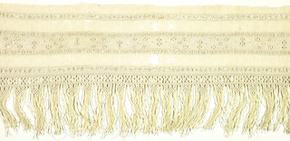 Towel end of float-patterned linen has narrow bands of geometric patterning made with needlemade filling stitches. Towel is finished with a fringe of fine macramé.
